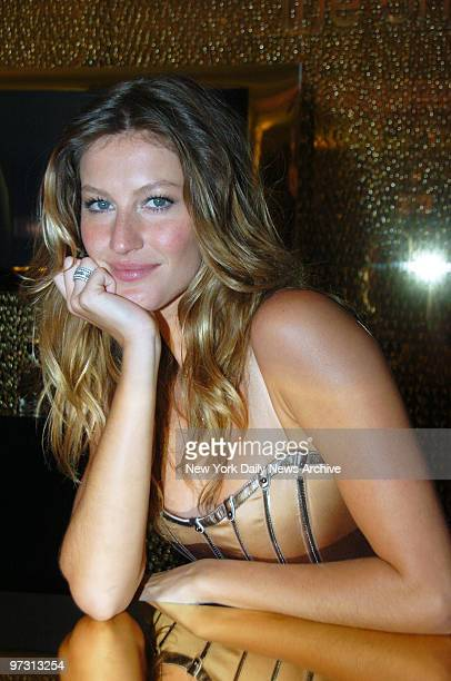 """Gisele Bundchen is at Saks Fifth Avenue to unveil Dolce & Gabbana's fragrance """"The One."""" She's the spokesmodel for the new perfume."""