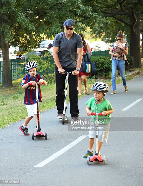 Gisele Bundchen is seen carrying her daughter Vivan Brady with Tom Brady and Jack Moynihan and Benjamin Brady on August 30 2013 in Boston...