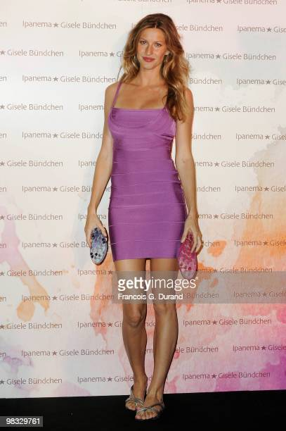 """Gisele Bundchen poses at a photocall to promote """"Ipanema"""" New Footwear Collection at Grand Hotel Intercontinental on April 8, 2010 in Paris, France."""