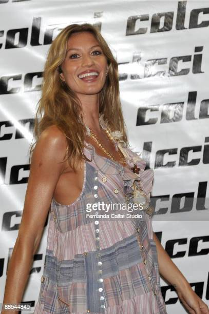 Gisele Bundchen poses for a photograf at Colcci during the first day of Sao Paulo Fashion Week SpringSummer 2010 collection at the Bienal Pavilion in...
