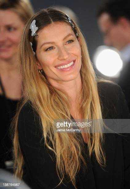 Gisele Bundchen prepares backstage at the Alexander Wang Fall 2012 fashion show during MercedesBenz Fashion Week at the Pier 94 on February 11 2012...
