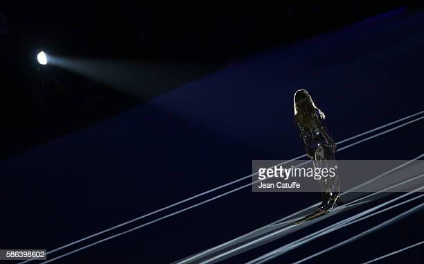 Gisele Bundchen walks across the stadium during the opening ceremony of the 2016 Summer Olympics at Maracana Stadium on August 5 2016 in Rio de...