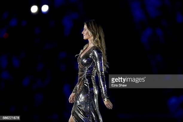 Gisele Bundchen walks on the stage during the Opening Ceremony of the Rio 2016 Olympic Games at Maracana Stadium on August 5 2016 in Rio de Janeiro...