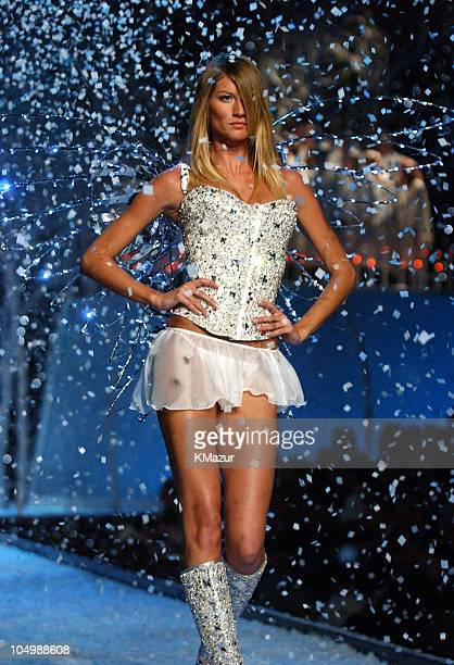 Gisele Bundchen wearing custom embellished crystal corset white Victoria's Secret second skin satin bikini and short chiffon skirt in white