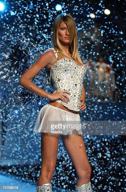 Gisele Bundchen wearing custom embellished crystal corset white Victoria's Secret second skin satin bikini and short chiffon skirt in white during...