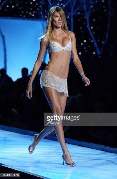 Gisele Bundchen wearing ice embellished Victoria's Secret bra and short leather skirt