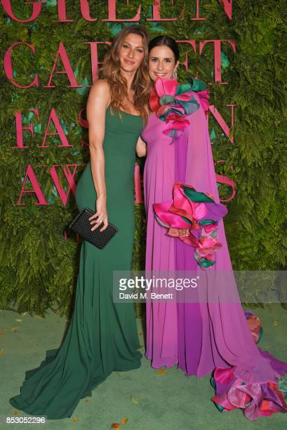 Gisele Bundchen wearing Roberto Capucci for the Green Carpet Challenge and Livia Firth wearing Roberto Capucci for the Green Carpet Challenge attend...