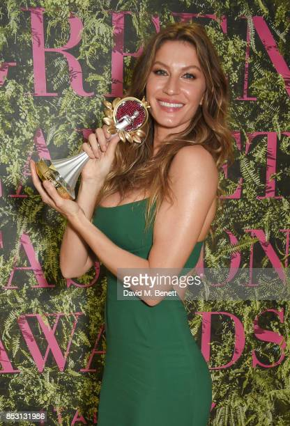 Gisele Bundchen winner of The Vogue Eco Laureate Award poses backstage at The Green Carpet Fashion Awards Italia at Teatro Alla Scala on September 24...