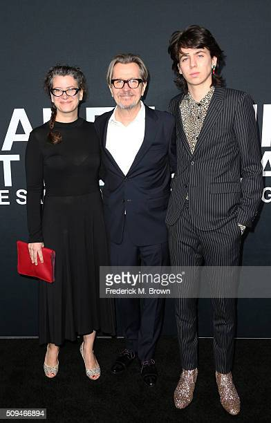 Gisele Schmidt actor Gary Oldman and model Charlie Oldman arrive at the Saint Laurent show at The Hollywood Palladium on February 10 2016 in Los...