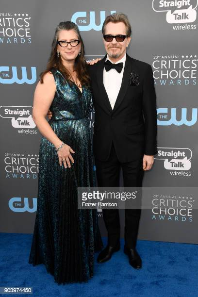 Gisele Schmidt and actor Gary Oldman attend The 23rd Annual Critics' Choice Awards at Barker Hangar on January 11 2018 in Santa Monica California