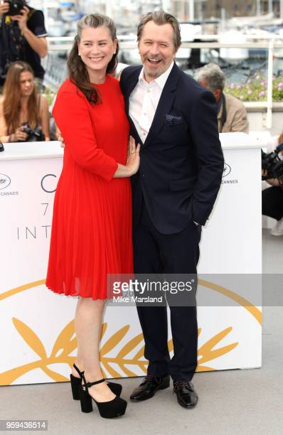 Gisele Schmidt and Gary Oldman attend the photocall for RendezVous With Gary Oldman during the 71st annual Cannes Film Festival at Palais des...