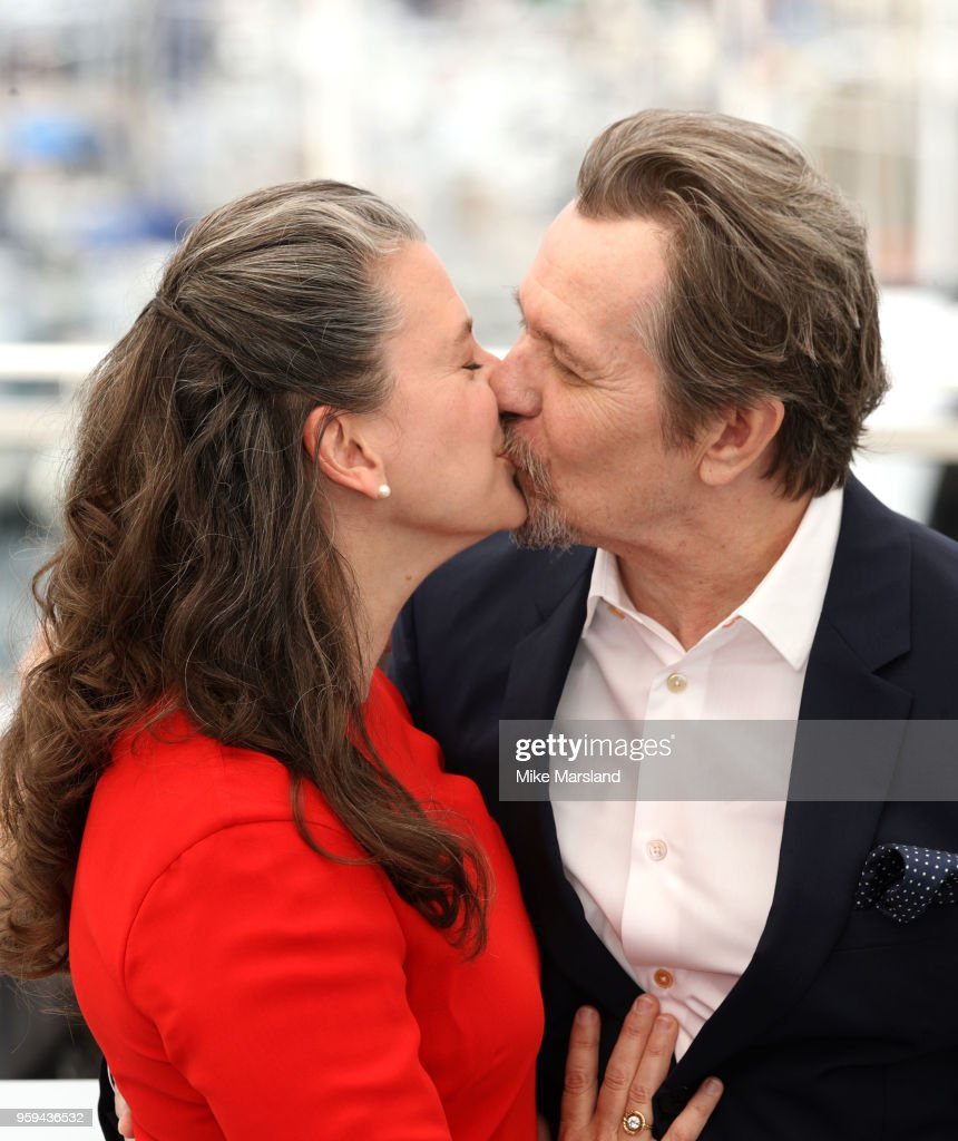 Gisele Schmidt and Gary Oldman attend the photocall for Rendez-Vous With Gary Oldman during the 71st annual Cannes Film Festival at Palais des Festivals on May 17, 2018 in Cannes, France.