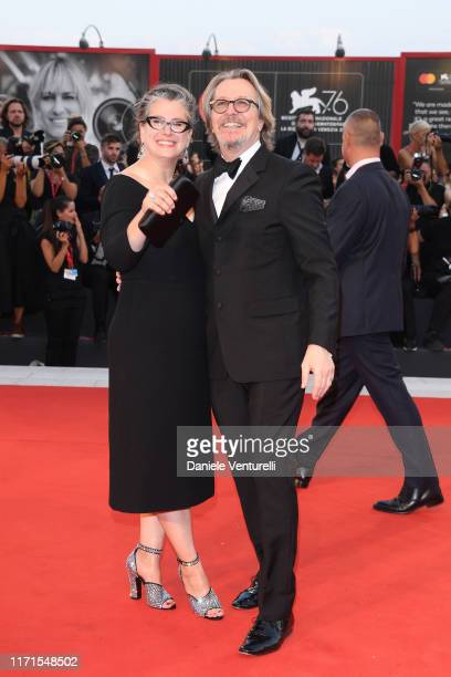 Gisele Schmidt and Gary Oldman walk the red carpet ahead of the The Laundromat screening during the 76th Venice Film Festival at Sala Grande on...