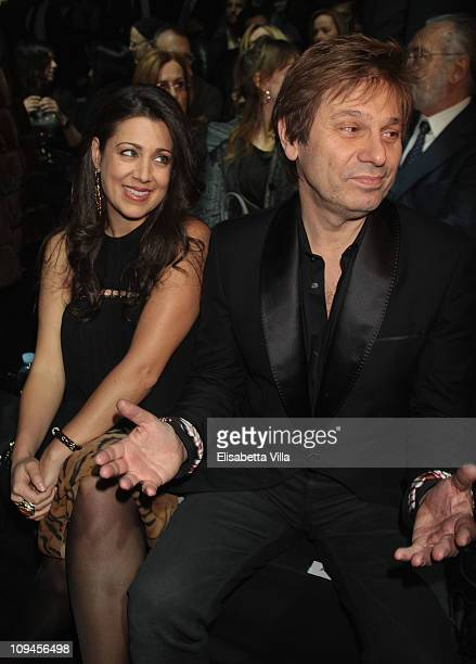 Gisella Bernales and Roger Taylor attend Roberto Cavalli fashion show as part of Milan Fashion Week Womenswear Autumn/Winter 2011 on February 26 2011...
