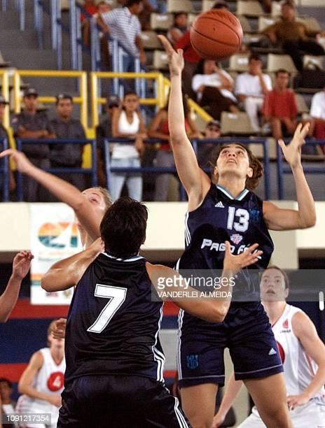Gisella Vega of Argentina grabs the ball near teammate Iris Ferazzoli and Canadian Michele Hendry 14 September 2001 in Sao Luis do Maranhao Brazil...