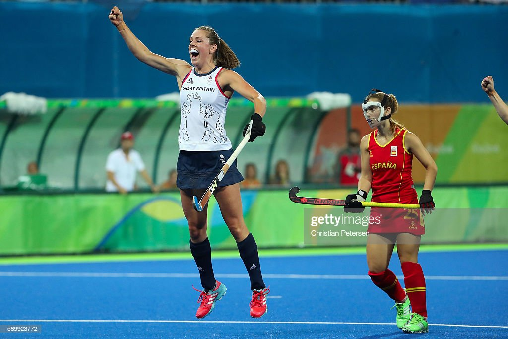 Giselle Ansley #18 of Great Britain celebrates ahead of Alicia Magaz #25 of Spain after Georgie Twigg (not pictured) scored a first half goal during the quarter final hockey game on Day 10 of the Rio 2016 Olympic Games at the Olympic Hockey Centre on August 15, 2016 in Rio de Janeiro, Brazil.