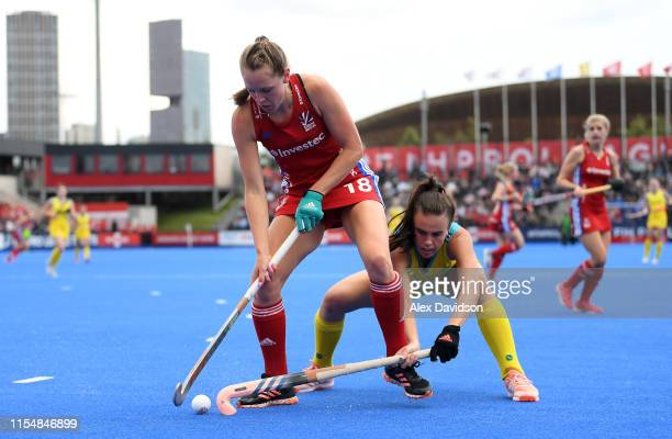 Giselle Ansley of Great Britain competes with Savannah Fitzpatrick of Australia during the Women's FIH Field Hockey Pro League match between Great...