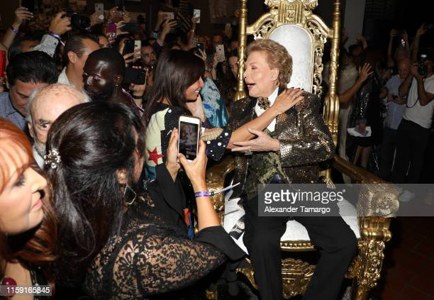 Giselle Blondet and Walter Mercado are seen at the opening of Mucho Mucho Amor 50 Years of Walter Mercado at HistoryMiami Museum on August 1 2019 in...