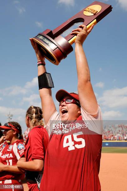 Giselle Juarez of the Oklahoma Sooners celebrates with teammates after winning Game 3 of the Women's College World Series Championship against the...