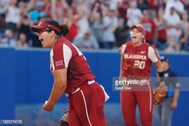 Giselle Juarez of the Oklahoma Sooners reacts after pitching the final out during the seventh inning of Game 2 of the Women's College World Series...