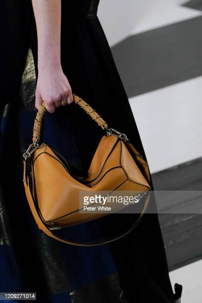 Giselle Norman, bag detail, walks the runway during the Loewe show as part of the Paris Fashion Week Womenswear Fall/Winter 2020/2021 on February 28,...