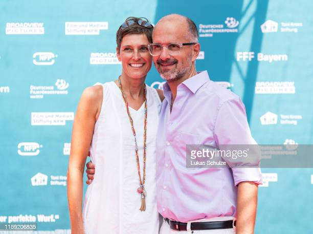 "Gisi Herbst and Christoph Maria Herbst attend the world premiere of the film ""Kroos"" at Cinedom on June 30, 2019 in Cologne, Germany."