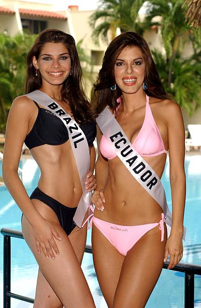 Gislaine Ferreira Miss Brazil 2003 and Andrea Marceia Jacome Ruiz Miss Ecuador 2003 pose in swimwear during registration and fittings at the Hotel El...
