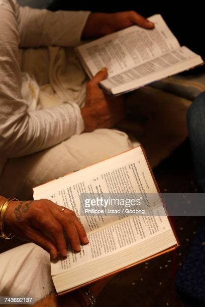 Gita Jayanti celebration in an ISKCON temple. Devotees reading the Bhagavad Gita. France.