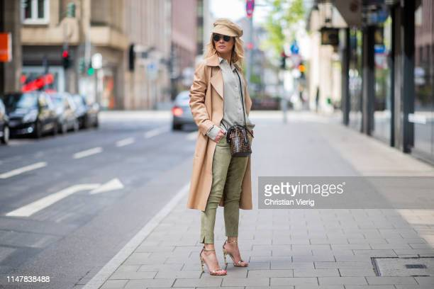 Gitta Banko is seen wearing a frayed blouse in khaki by Bella Dahl, green soft suede leather pants and a nougat-colored leather coat by Arma, golden...