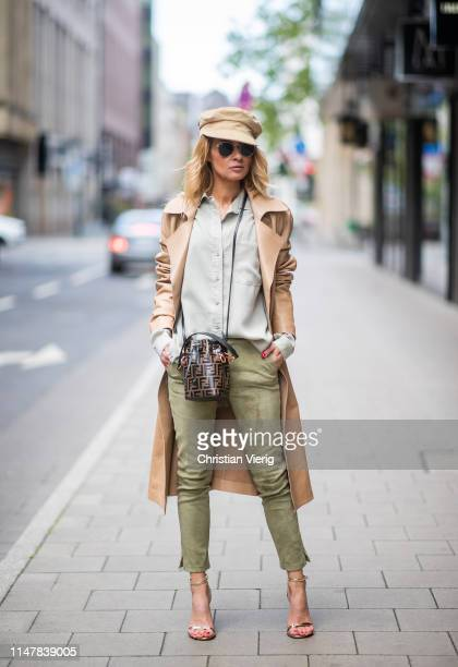 Gitta Banko is seen wearing a frayed blouse in khaki by Bella Dahl green soft suede leather pants and a nougatcolored leather coat by Arma golden...