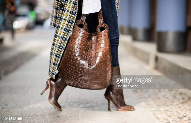 Gitta Banko is seen wearing a houndstooth coat with fake für applications by Steffen Schraut Statement blouse by Redirection two black leather belts...