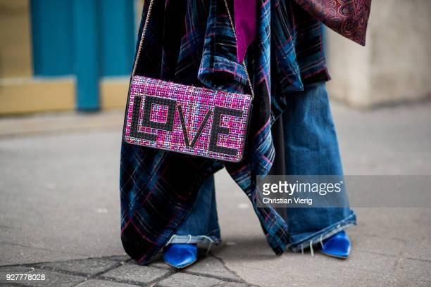 Gitta Banko is seen wearing a striped turtleneck sweater by AirField blue checked velvet dress by Dawid Tomaszewski violet velvet blazer by Dawid...