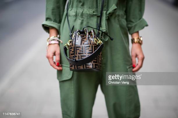 "Gitta Banko is seen wearing an olive greencolored boiler suit by Surplus a mini logo print ""Tresor"" bucket bag by Fendi on May 05 2019 in Duesseldorf..."