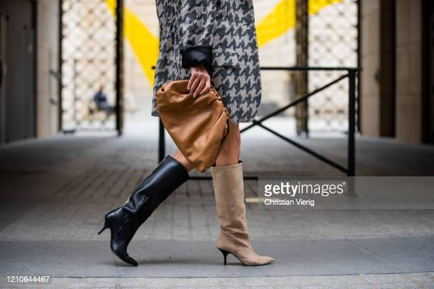 Gitta Banko is seen wearing creme corduroy paperbag shorts by The Frankie Shop, oversized wool houndstooth blazer by Boscana, two tone boots by...