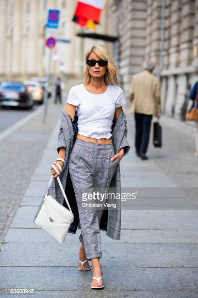 Gitta Banko is seen wearing grey checked pants and checked oversizefitted coat by Steffen Schraut white shirt from thelinebyK white patent leather...