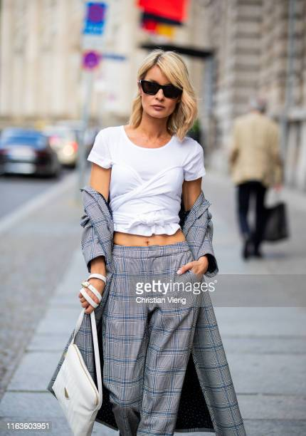Gitta Banko is seen wearing grey checked pants and checked oversizefitted coat by Steffen Schraut white shirt from thelinebyK snowwhite Dakar...