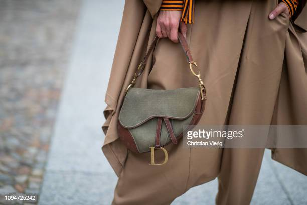 Gitta Banko is seen wearing olive green vintage canvas Dior Saddle bag during the Berlin Fashion Week Autumn/Winter 2019 on January 15 2019 in Berlin...