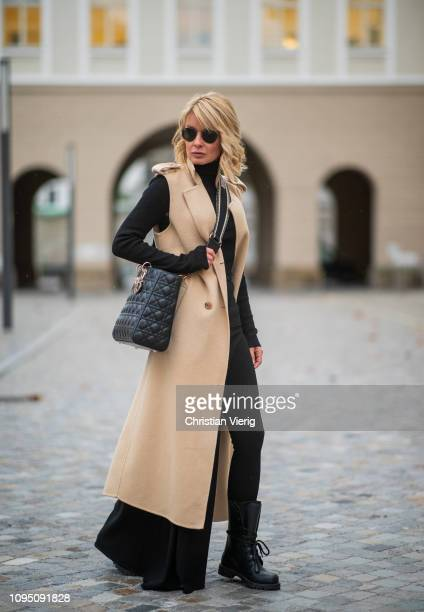 Gitta Banko is seen wearing wearing black knitted pantyhose under asymmetric skirtpants by Jacquemus black sweater by Steffen Schraut nudecolored...