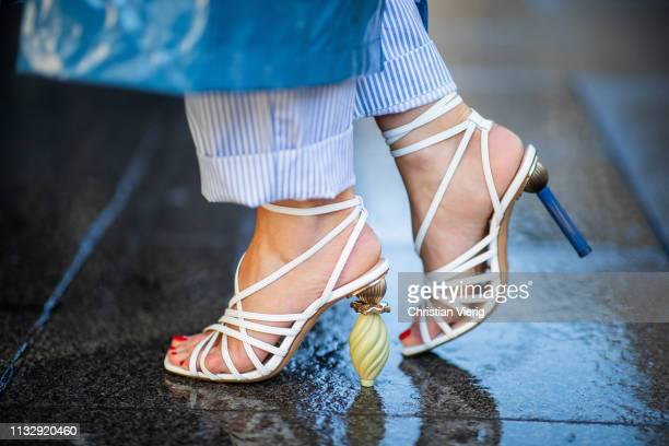 Gitta Banko is seen wearing white strappy sandals with architectural heels by Jacquemus during Paris Fashion Week Womenswear Fall/Winter 2019/2020 on...