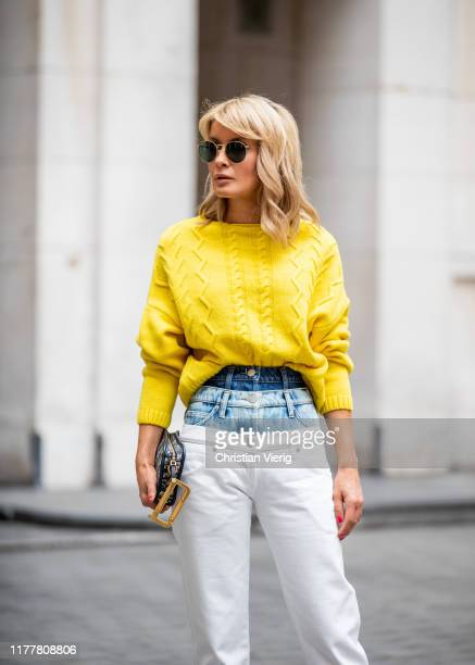 Gitta Banko is seen wearing yellow cashmere sweater by Boscana a pair of triple layered skinny jeans by Natasha Zinko Diorquake clutch by Dior during...