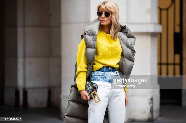 Gitta Banko is seen wearing yellow cashmere sweater by Boscana a pair of triple layered skinny jeans by Natasha Zinko an oversized down vest by Dawid...