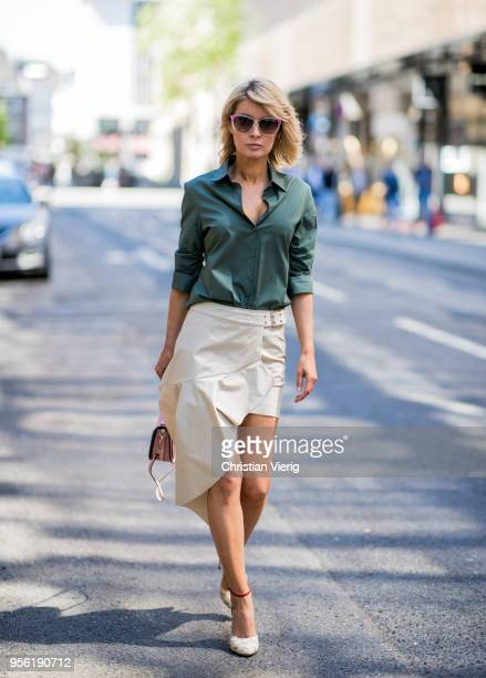 Gitta Banko wearing a beige asymmetrical skirt with flounces by Patrizia Pepe khaki colored blouse by Steffen Schraut rounded point toe leather pumps...