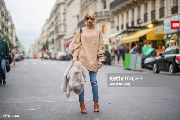 Gitta Banko wearing a beige oversize sweater from HM grey fake fur jacket by Betta Corradi used look jeans by R13 brown Bistrot midlength leather...