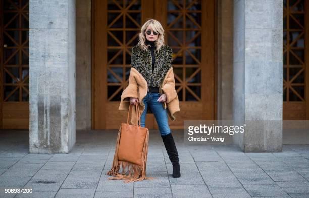 Gitta Banko wearing a black cashmere turtleneck sweater by Bruno Manetti olivegreen fake fur jacket with leopard pattern by True Religion...