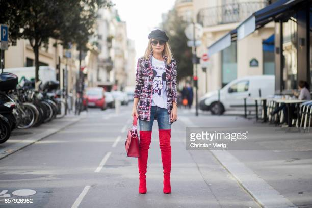 Gitta Banko wearing a checked tweed jacket by AirField hand painted Mickey Mouse tshirt by Wodka Ogurez JBrand jeans red suede overknee boots by...