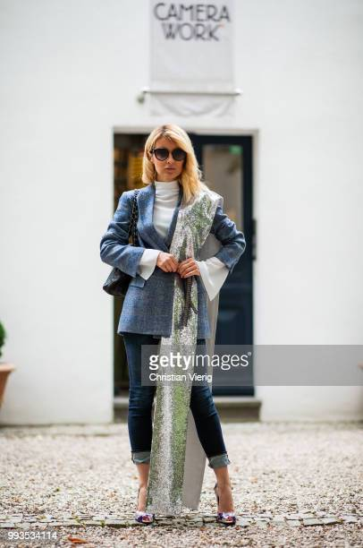 Gitta Banko wearing a darkblue checked alpaca tweed blazer white silk blouse and silver sequin scarf by Agnona dark blue jeans by Citizens of...
