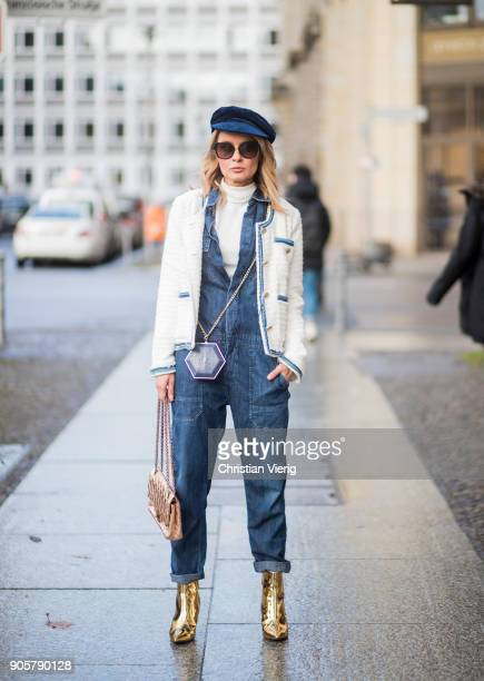 Gitta Banko wearing a darkblue Demin overall by Citizens of Humanity white turtleneck sweater from Hallhuber white tweed jacket with golden buttons...