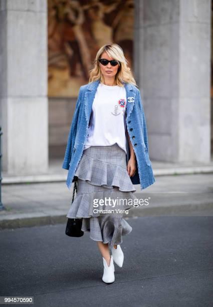 Gitta Banko wearing a denimtweed blazer by Air Field white tshirt with hand painted Chanel brooch motive by Wodka Ogurez grey checked asymmetric...