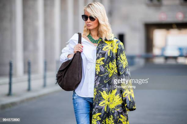 Gitta Banko wearing a floral patterned coat by Steffen Schraut white offshoulder blouse with asymmetrical cut by Balossa brown suede bag by Amma Mode...