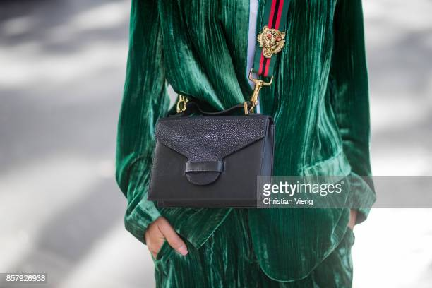 Gitta Banko wearing a green velvet suit by Jadicted white cotton shirt by Dsquared 2 black sock boots from Mango a Suzy suitcase handbag made of...